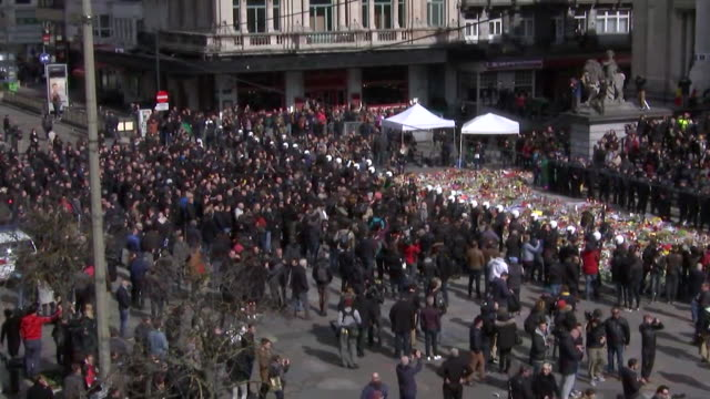 stockvideo's en b-roll-footage met overhead shot of police creating a barrier outside of the flower tribute set up by the protesters in front of place de la bourse related to the... - business or economy or employment and labor or financial market or finance or agriculture