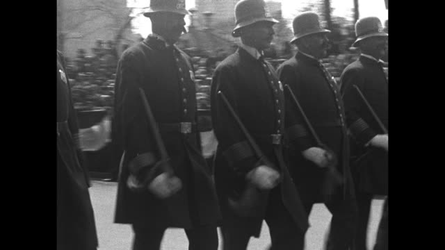 overhead shot of policemen marching in formation down fifth avenue in manhattan, with us flags hanging from buildings lining the street / two street... - top hat stock videos & royalty-free footage