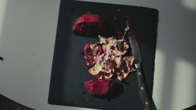 Overhead shot of pomegranate skin with seeds