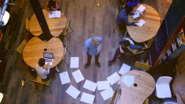 Overhead shot of professionals working on project.