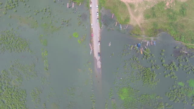 Overhead Shot of Rural Street Cover by Water, Road Running Through Submerged Fields