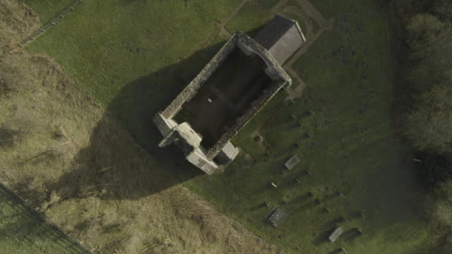 overhead shot of the ruined st martins church of wharram percy - pull out camera movement stock videos & royalty-free footage