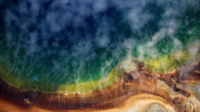 stockvideo's en b-roll-footage met overhead shot of the steaming edge of the grand prismatic spring - yellowstone national park