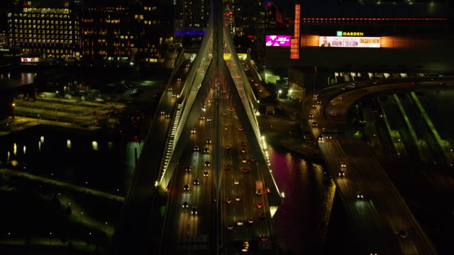 overhead shot of the traffic on the leonard p zakim bunker hill memorial bridge at night - boston massachusetts stock videos & royalty-free footage