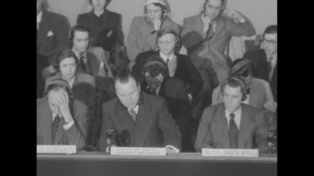 overhead shot of un delegates sitting at desks voice of secretary general gladwyn jebb can be heard speaking / delegate from soviet union yakov malik... - 1951 stock-videos und b-roll-filmmaterial