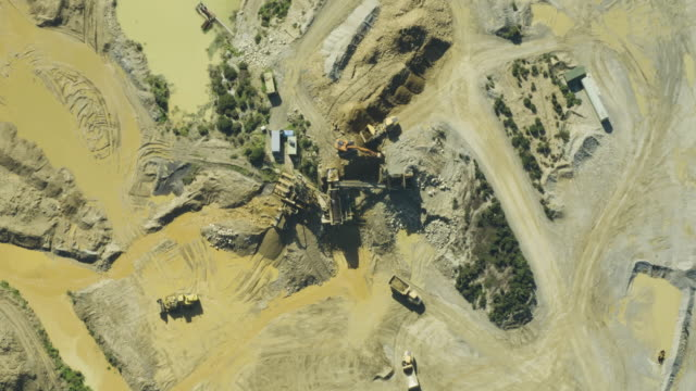 overhead shot of working mining machinery in the quarry - metal ore stock videos & royalty-free footage