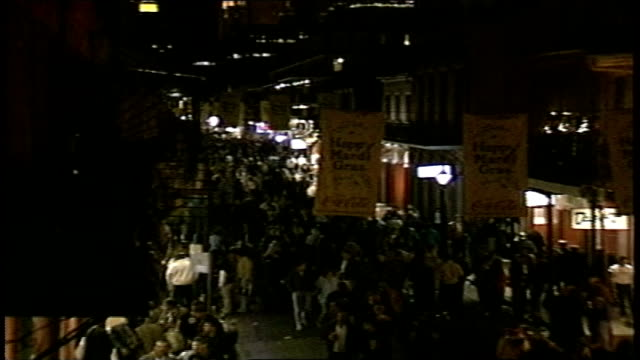 overhead shot street at night during mardi gras in new orleans - gras stock videos and b-roll footage