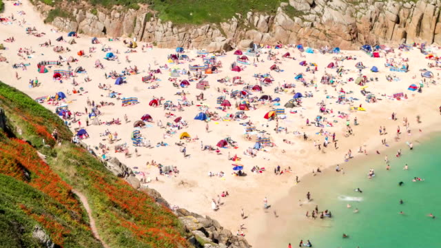 overhead timelapse of people on beach - cornwall england stock videos & royalty-free footage