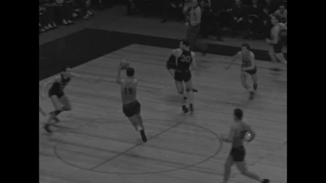 overhead view long island university brooklyn blackbirds v. minnesota university golden gophers / minnesota wins 56-41 with long shot from mid-court... - shooting baskets stock videos & royalty-free footage