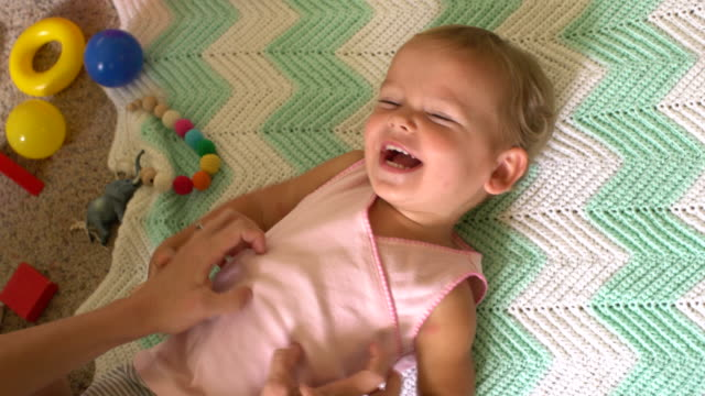 cu overhead view mother tickling baby. - tickling stock videos & royalty-free footage