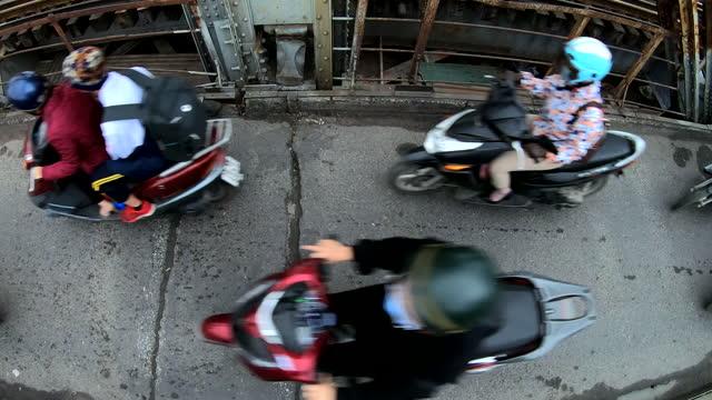 overhead view motorbike commuters crossing long bien bridge - bridge built structure stock videos & royalty-free footage