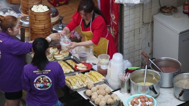 overhead view of a vendor selling food at a stall in the gongbei district of zhuhai guangdong province china on sunday nov 16 overhead view of a... - bamboo plant stock videos & royalty-free footage