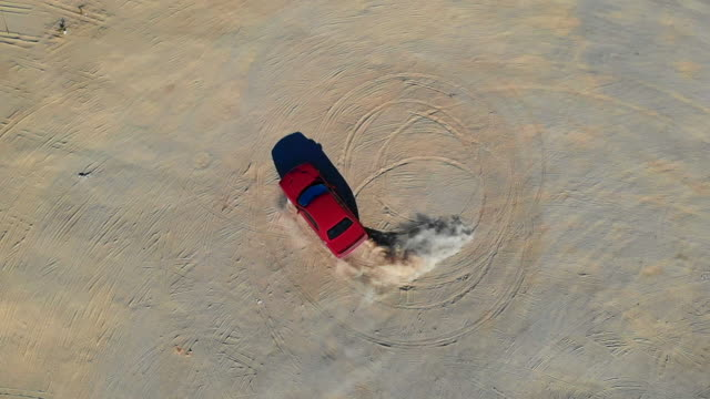 Overhead view of american car doing donuts in the desert of California.