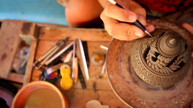 overhead view of carved pottery,dollyshot - craft stock videos & royalty-free footage