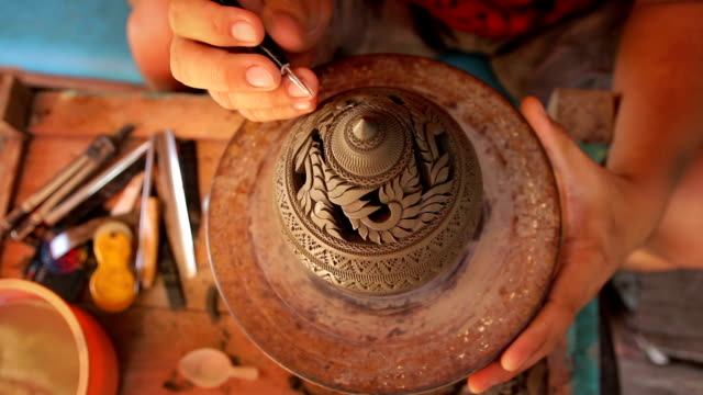 overhead view of carved pottery,dollyshot - pottery stock videos & royalty-free footage