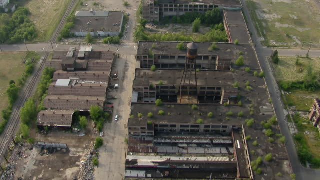 vídeos de stock, filmes e b-roll de overhead view of detroit's deserted packard automotive plant, in ruins. - michigan