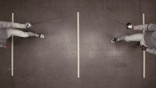 overhead view of fencer lunging forward towards his opponent