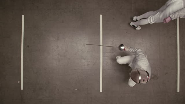 overhead view of fencer winning the match and making winning gestures