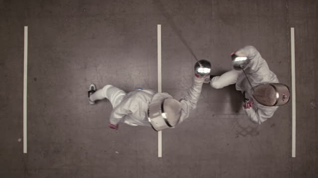 overhead view of fencer winning the match and yelling - 勝つ点の映像素材/bロール