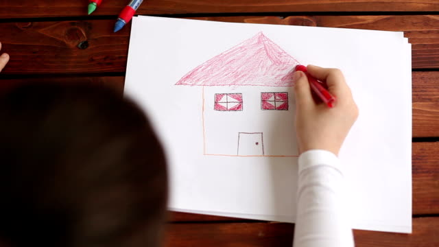 overhead view of girl drawing on the white paper - home ownership stock videos & royalty-free footage