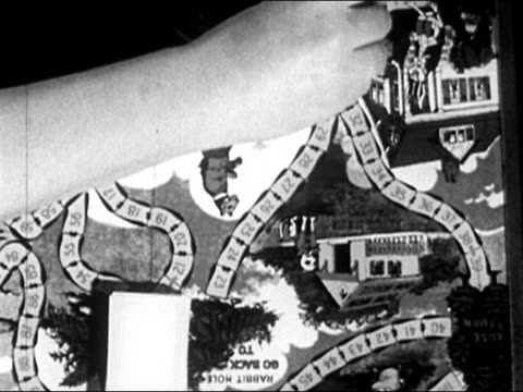1950 Overhead view of hands playing 'Uncle Wiggily Game' board game / AUDIO