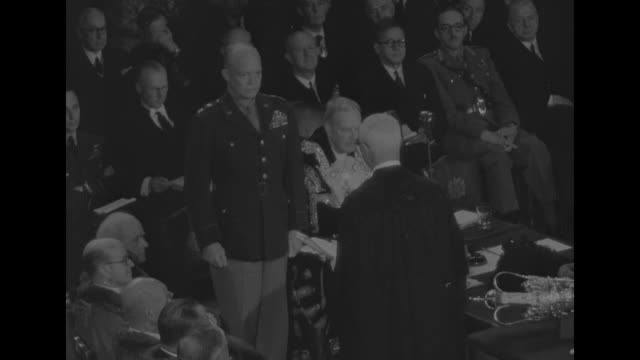 overhead view of lady clementine churchill and british prime minister winston churchill walking up aisle inside guildhall and being greeted by lord... - allied forces stock videos and b-roll footage