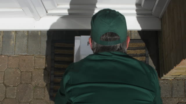 overhead view of parcels being delivered to domestic door. - doorstep stock videos & royalty-free footage