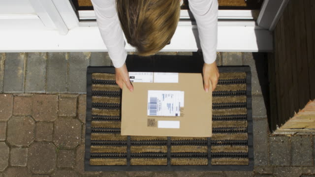overhead view of parcels being delivered to domestic door.door opens and parcels are retrieved. - front stoop stock videos & royalty-free footage