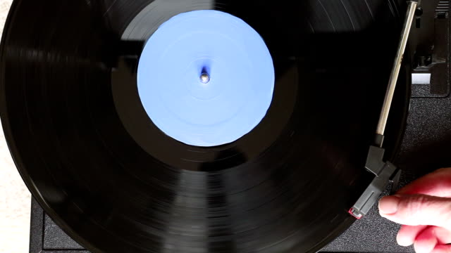 overhead view of record being turned on - record player stock videos & royalty-free footage