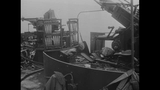 overhead view of rocket launchers on deck of damaged ship / shot of gun on deck of damaged ship / dead sailor lying on deck of damaged ship / wounded... - schiffsdeck stock-videos und b-roll-filmmaterial