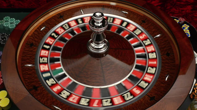 overhead view of roulette wheel and croupier - roulette wheel stock videos and b-roll footage
