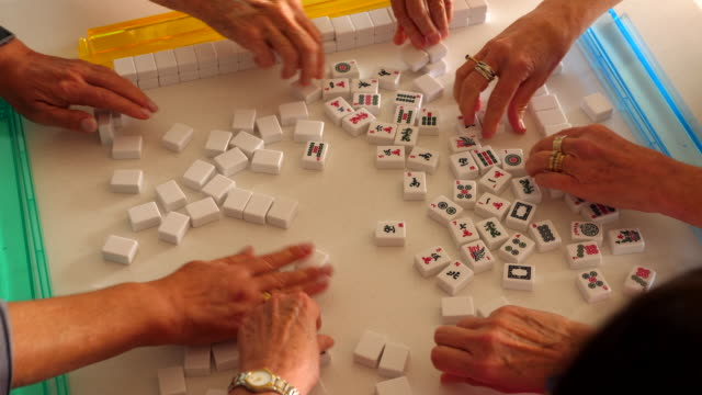 ms overhead view of senior women organizing tiles while playing mahjong - alternative energy stock videos & royalty-free footage