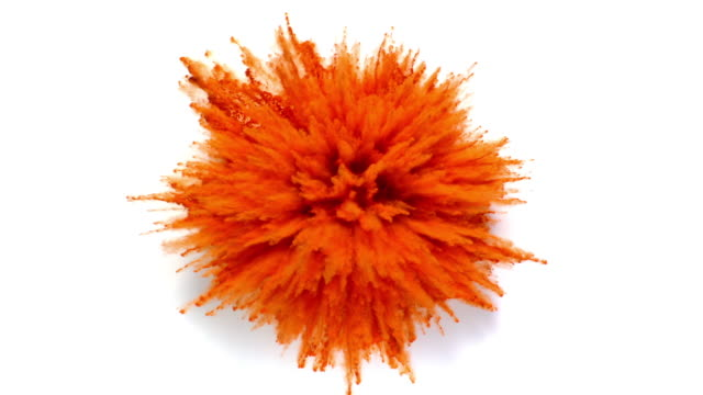 overhead view of single radial shaped orange powder exploding towards camera, in close up and super slow motion, white background - orange stock videos & royalty-free footage