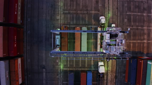 overhead view of straddle carrier lifting cargo container - straddle carrier stock videos & royalty-free footage