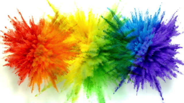 overhead view of three radial shaped powders in two colors exploding towards camera, in close up and slow motion, white background - three objects stock videos & royalty-free footage