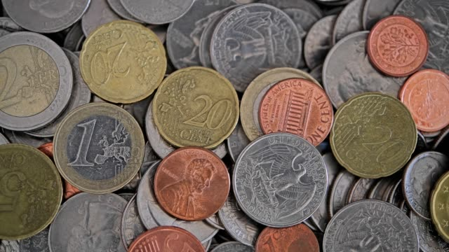 overhead view of u.s. coins and euro coins - five cent coin stock videos & royalty-free footage