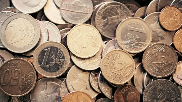 overhead view of u.s. coins and euro coins - european union coin stock videos & royalty-free footage