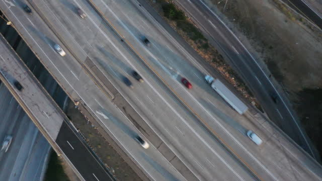 overhead view of vehicles travel along the i-405/i-110 freeway interchange ahead of memorial day weekend in gardena, ca, u.s. on friday, may 28, 2021. - city of los angeles stock videos & royalty-free footage