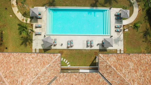overhead view of villa roof and swimming pool - villa stock videos & royalty-free footage