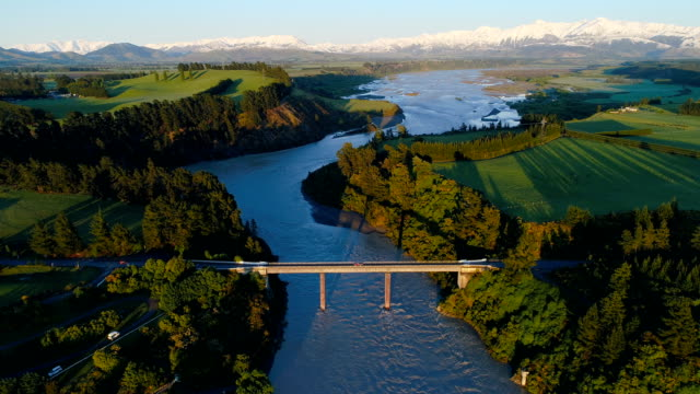 overhead view of waimakariri river just after sunrise. - sustainable tourism stock videos & royalty-free footage