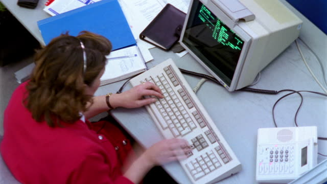 t/l, overhead view of woman wearing headset using computer in office - retro style stock videos & royalty-free footage