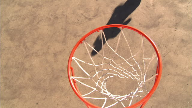 overhead view over basketball hoop of young woman making layup - basketball hoop stock videos & royalty-free footage