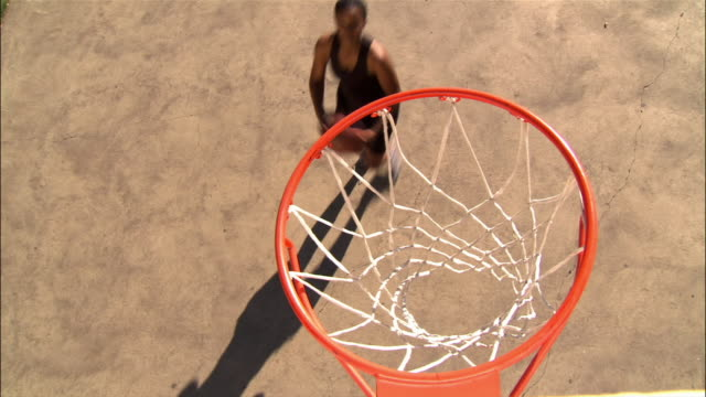 overhead view over basketball hoop of young woman missing layup - basketball hoop stock videos & royalty-free footage