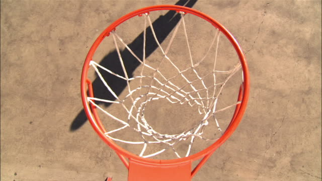 overhead view over basketball hoop of young woman shooting layups - basketball hoop stock videos & royalty-free footage