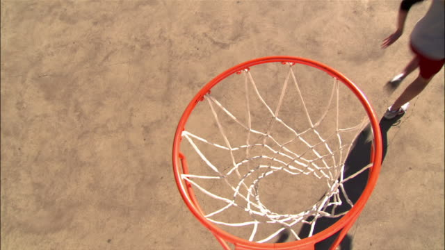 overhead view over basketball hoop of young women making layups - basketball hoop stock videos & royalty-free footage