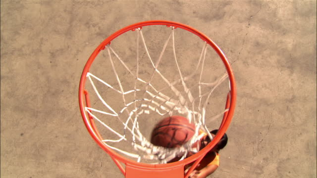 overhead view over basketball hoop of young women shooting layups - basketball hoop stock videos & royalty-free footage