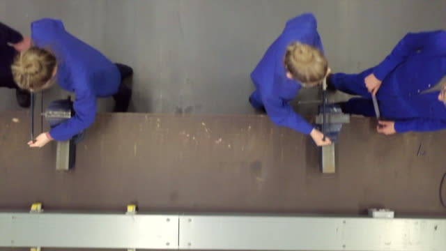 overhead view sawing in workshop - trainee stock videos & royalty-free footage