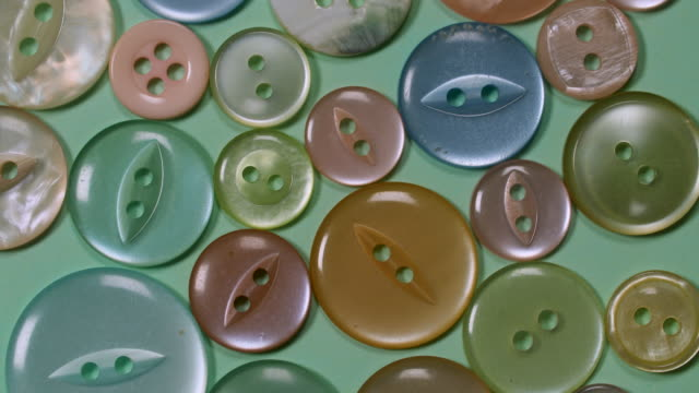 cu overhead vintage buttons rotate - green background stock videos & royalty-free footage