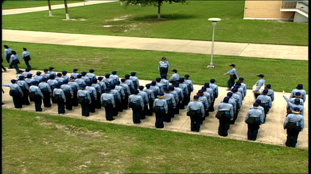 stockvideo's en b-roll-footage met overhead wide shot of naval recruits lining up in formation - militaire training