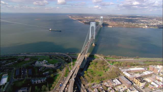 overhead wide shot pan brooklyn/queens expressway in brooklyn/ tilt up wide shot verrazano-narrows bridge and tanker in new york bay/ brooklyn, new york - staten island stock videos and b-roll footage